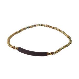 Dainty bronze beaded stretch bracelet with a thread wrap focal.