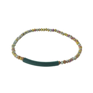 Dainty mint green iridescent beaded stretch bracelet with a thread wrap focal.