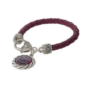 Officially licensed, University of South Carolina faux leather bracelet with a silver tone clasp and a logo charm.