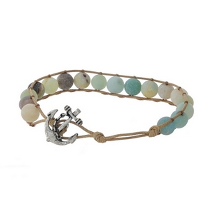 Tan cord bracelet featuring amazonite natural stone beads and a silver tone anchor toggle closure.