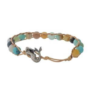 Tan cord bracelet featuring amazonite natural stone beads and a silver tone mermaid toggle closure.