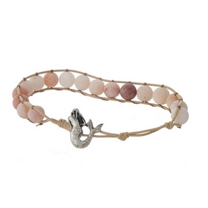Tan cord bracelet featuring peach natural stone beads and a silver tone mermaid toggle closure.