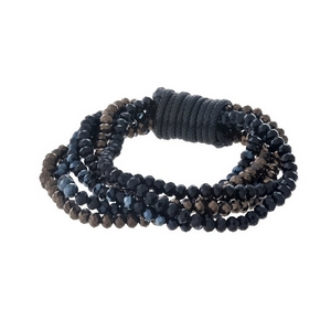Multi strand beaded stretch bracelet with black, bronze, and hematite faceted beads.