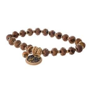 Bronze and gold tone beaded stretch bracelet featuring a circle charm.