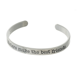 "Silver tone cuff bracelet stamped with ""Sisters make the best friends."""
