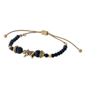 Black beaded pull-tie bracelet with a gold tone elephant focal.