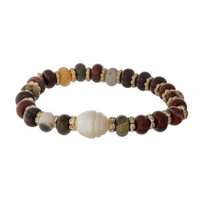 Burgundy semi-precious stone stretch bracelet with a freshwater pearl bead accent.