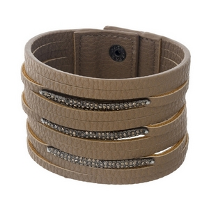 """Taupe faux leather bracelet with hematite rhinestones. Approximately 2"""" in width."""