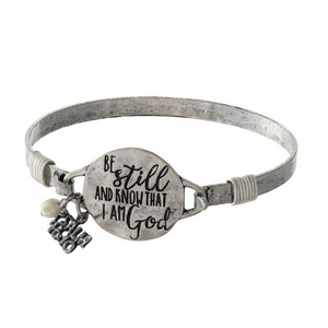"""Silver tone bangle bracelet stamped with """"Be still and know that I am God."""""""