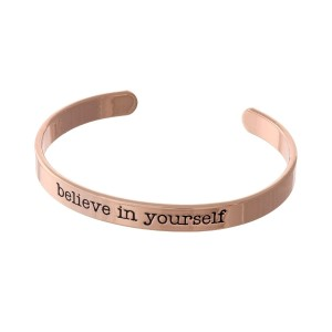 "Rose gold tone cuff bracelet stamped with ""believe in yourself."""