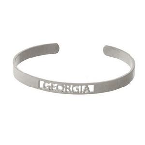 Silver tone cuff bracelet with a Georgia cutout.