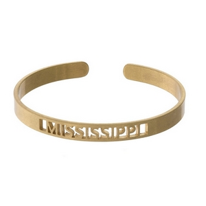 Gold tone cuff bracelet with a Mississippi cutout.