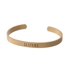 """Gold tone cuff bracelet stamped with """"Sisters."""""""