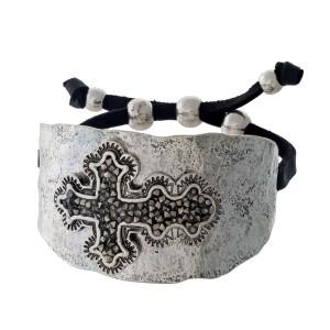 Silver tone cuff bracelet with a hematite stone cross.