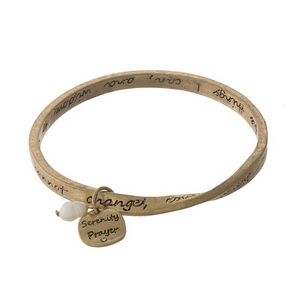 Gold tone bangle bracelet stamped with the Serenity Prayer.