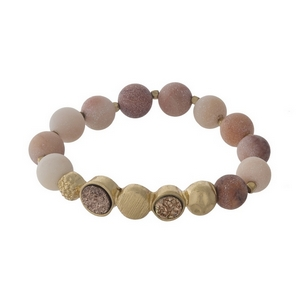 Peach beaded stretch bracelet with faux druzy stones and gold tone accents.