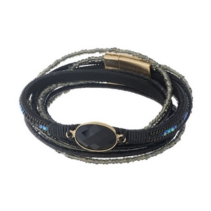 Black leather wrap bracelet with black beads and a gold tone magnetic closure.