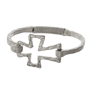 Silver tone bangle bracelet with an open cross focal.