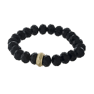 Black beaded stretch bracelet with a gold tone accent.