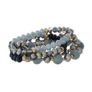 Four piece, gray beaded stretch bracelet set with thread wrapped beads and gold tone accents.