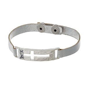 Metallic silver faux leather snap bracelet with a silver tone cross focal.