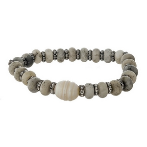 Gray semi-precious stone stretch bracelet with a freshwater pearl bead accent.