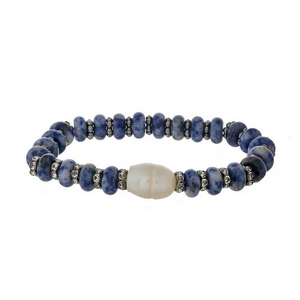 Blue semi-precious stone stretch bracelet with a freshwater pearl bead accent.