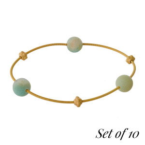 Set of 10, gold tone stretch bracelets with three natural stone beads. Set comes with the following natural stones: lapis, gray, picture jasper, beige, carnelian, labradorite, green, tiger's eye, dalmatian jasper, and amazonite.