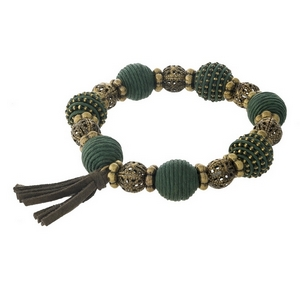 Olive green thread wrapped and burnished gold tone, stretch bracelet with a tassel accent.