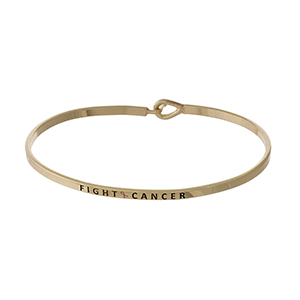 "Dainty gold tone Breast Cancer Awareness bracelet, stamped with ""Fight Cancer."""