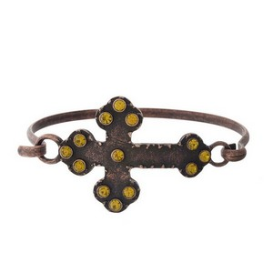 Burnished metal bracelet with a cross focal and rhinestone accents.