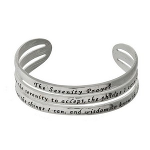 Silver tone cuff bracelet stamped with The Serenity Prayer.