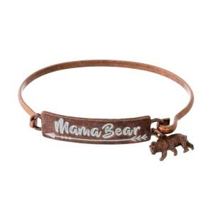 "Metal bangle bracelet stamped with ""Mama Bear"" and a bear charm."