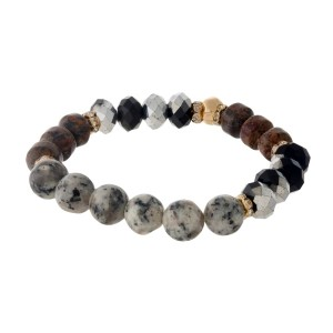 Black and gray, natural stone beaded stretch bracelet with gold tone accents.
