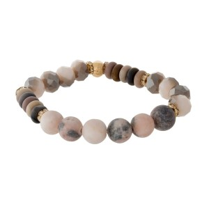 Gray and mauve, natural stone beaded stretch bracelet with gold tone accents.