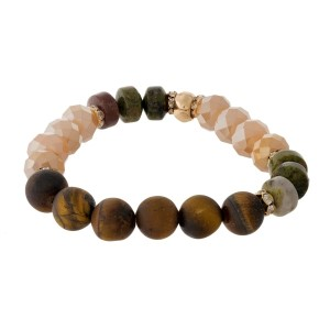 Champagne and tiger's eye, natural stone beaded stretch bracelet with gold tone accents.