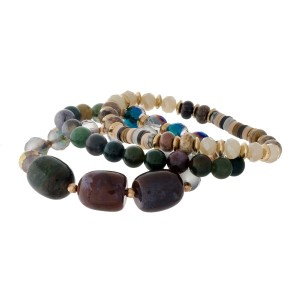 Three piece, hunter green and ivory, natural stone beaded stretch bracelet set with gold tone accents.