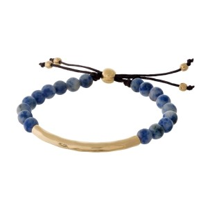 Sodalite, natural stone beaded pull-tie bracelet with a hammered gold tone bar.