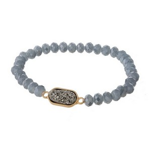 Dainty, faceted bead stretch bracelet with a gold tone, faux druzy stone focal.
