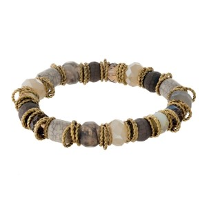 Champagne and ivory natural stone beaded stretch bracelet with gold tone, twisted accents.