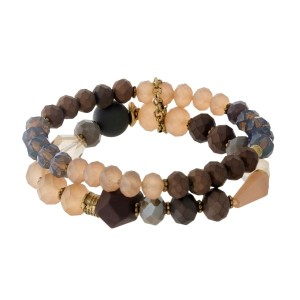 Brown, ivory and gray beaded, two-row stretch bracelet with a matte finish and gold tone accents.