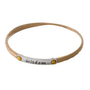 "Gold tone bangle bracelet with a two tone bar, stamped with ""Wisdom."""