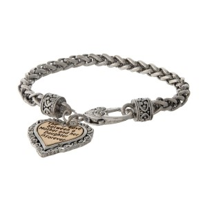 """Silver tone bracelet with a two tone heart charm stamped with """"The love between a Mother and her Daughter is forever."""""""