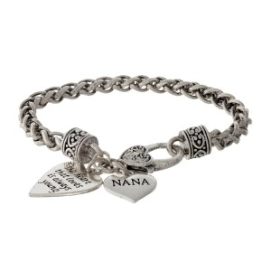 "Silver tone bracelet with two heart charms stamped with ""The heart that loves is always young"" and ""Nana."""