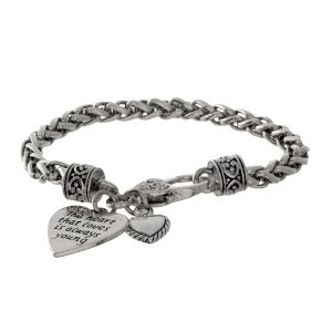 "Silver tone bracelet with two heart charms stamped with ""The heart that loves is always young."""