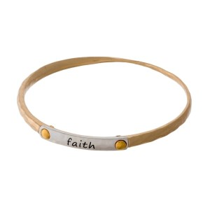 "Gold tone bangle bracelet with a two tone bar, stamped with ""Faith."""