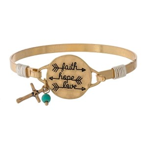 """Metal bangle bracelet with a circle focal stamped with """"Faith Hope, Love."""""""
