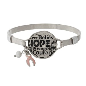 """Metal bangle bracelet with a circle focal stamped with """"Hope, Courage, Strength, Faith, Believe."""""""