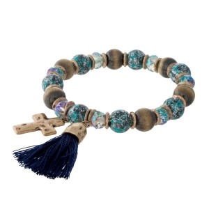 Turquoise and brown, beaded stretch bracelet with cross and tassel charms.