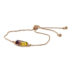 Dainty gold tone, pull-tie bracelet with an ombre oval stone.